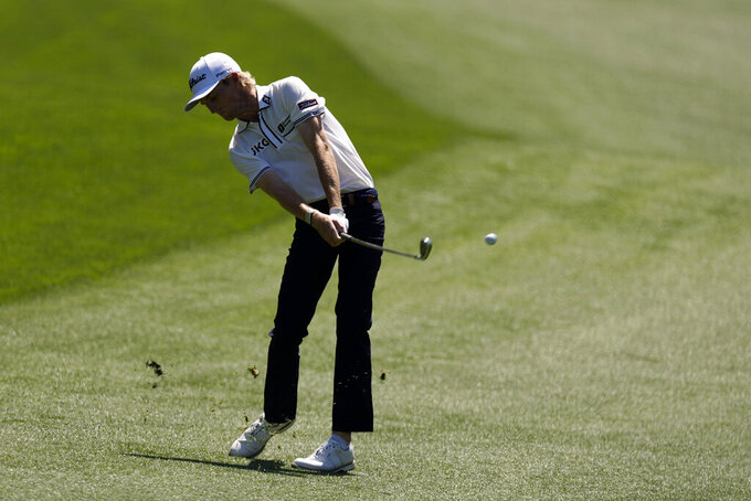 Will Zalatoris hits from the fairway on the 13th hole during a practice round for the Masters golf tournament on Monday, April 5, 2021, in Augusta, Ga. (AP Photo/Charlie Riedel)