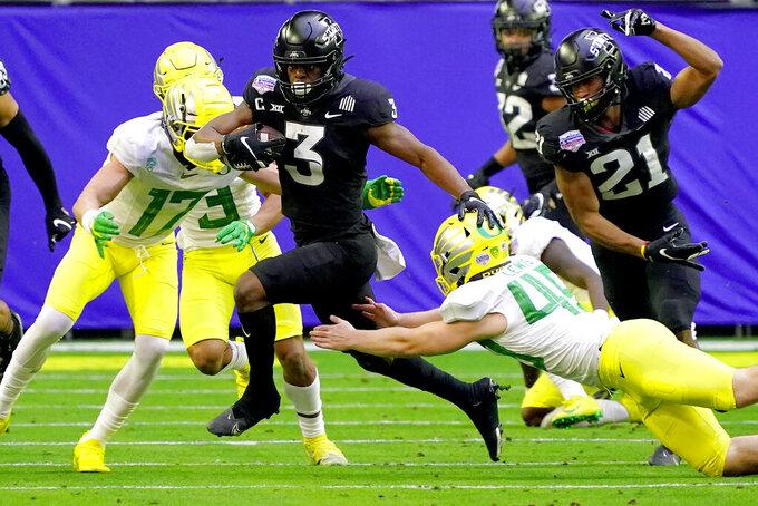 Iowa State running back Kene Nwangwu (3) runs as Oregon tight end Cooper Shults (45) defends during the first half of the Fiesta Bowl NCAA college football game, Saturday, Jan. 2, 2021, in Glendale, Ariz. (AP Photo/Rick Scuteri)
