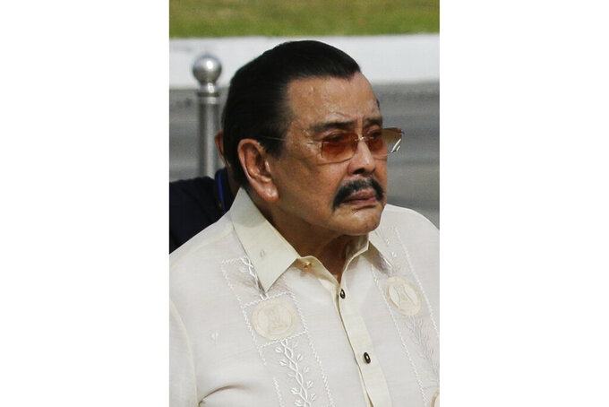 FILE - This June 12, 2019, file photo shows former Manila City Mayor Joseph Estrada during wreath-laying ceremonies to mark the 121st anniversary of Philippine independence at Manila's Rizal Park, Philippines. Former Philippine President Estrada has been put on a ventilator in a hospital to help him breath after being infected by the coronavirus, his son said Tuesday, April 6. (AP Photo/Aaron Favila, File)