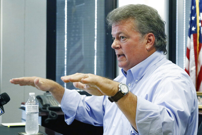 Mississippi Attorney General Jim Hood discusses an agreement reached recently with T-Mobile, as an alternative to litigation against the phone company's merger, at a Wednesday, Oct. 9, 2019 news conference at his office in Jackson, Miss. Hood, who is the Democratic nominee for governor, said as a result of the agreement, within three years of closing on the merger of T-Mobile and Sprint, T-Mobile will deploy a 5G network in Mississippi with at least 62 percent of the state's general and rural populations having access to download speeds equal to or greater than 100 Mbps and within six years of closing, it will cover at least 92 percent of Mississippi's general population and 88% of Mississippi's rural population. (AP Photo/Rogelio V. Solis)