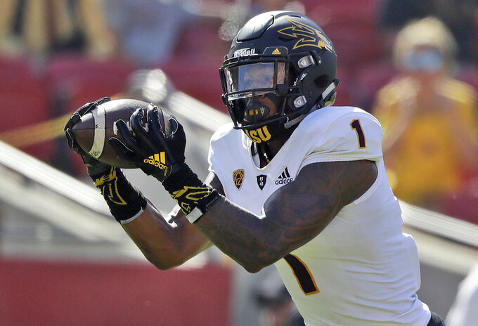 FILE - In this Oct. 27, 2018, file photo, Arizona State wide receiver N'Keal Harry makes a touchdown catch against Southern California during the first half of an NCAA college football game in Los Angeles. Harry announced Monday, Nov. 26, 2018, he will skip his senior season to enter the NFL draft. (AP Photo/Marcio Jose Sanchez, File)