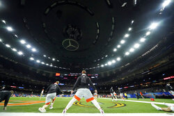 Clemson warms up before the Sugar Bowl NCAA college football game against Ohio State Friday, Jan. 1, 2021, in New Orleans. (AP Photo/Gerald Herbert)