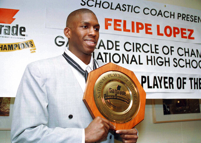 "FILE - In this March 15, 1994, file photo, Felipe Lopez, a senior at Rice High School in New York City, is named National High School Basketball Player of the Year during a news conference in New York. Lopez, once the top-rated player in the nation in high school, could never live up to the lofty expectations in college or the NBA. His story is told in the new film ""The Dominican Dream."" (AP Photo/Marty Lederhandler, File)"