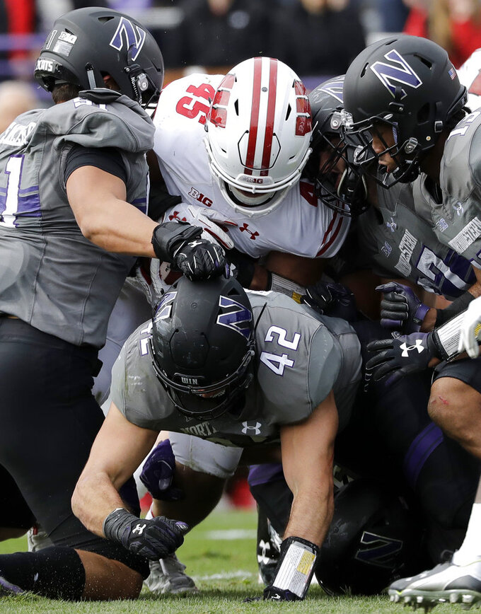 Wisconsin fullback Alec Ingold (45) is tackled by Northwestern defenders during the first half of an NCAA college football game in Evanston, Ill., Saturday, Oct. 27, 2018. (AP Photo/Nam Y. Huh)