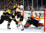 Boston Bruins right wing David Pastrnak (88) scores past Philadelphia Flyers goaltender Carter Hart (79) as Flyers defenseman Robert Hagg (8) looks on in the second period of an NHL hockey game, Thursday, Jan. 31, 2019, in Boston. (AP Photo/Elise Amendola)