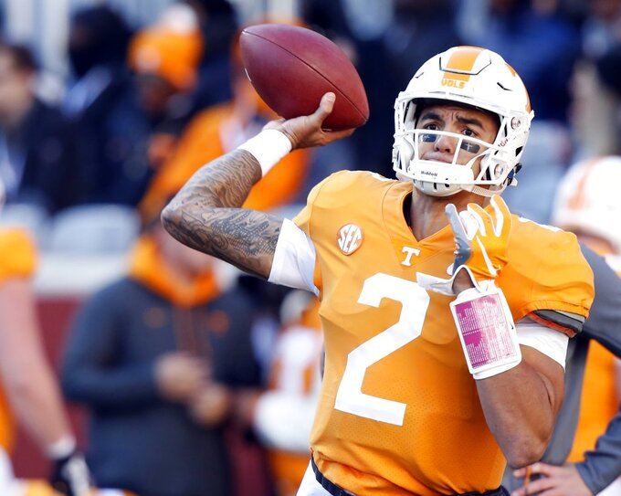 Tennessee quarterback Jarrett Guarantano (2) warmups before an NCAA college football game against Kentucky, Saturday, Nov. 10, 2018, in Knoxville, Tenn. (AP Photo/Wade Payne)
