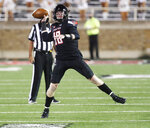 Texas Tech's quarterback Alex Bowman passes downfield in the first half of an NCAA college football game against Houston Baptist, Saturday, Sept. 12, 2020, in Lubbock, Texas. (AP Photo/Mark Rogers)