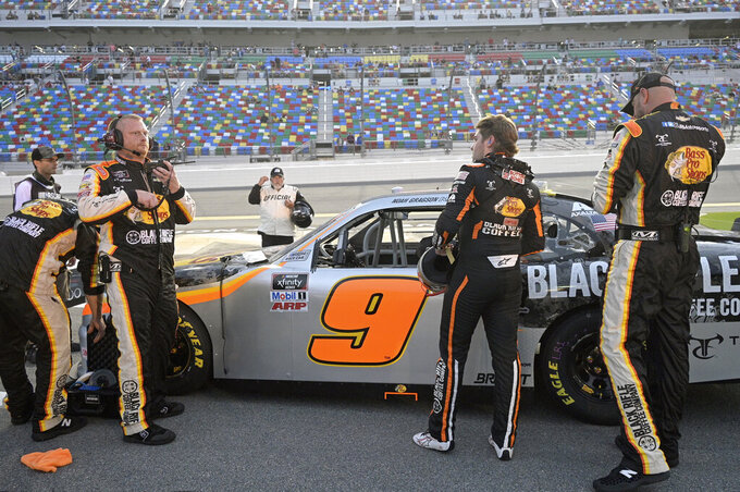 Noah Gragson (9), second from right, stands next to his car on pit road before a NASCAR Xfinity Series auto race at Daytona International Speedway, Friday, Aug. 27, 2021, in Daytona Beach, Fla. (AP Photo/Phelan M. Ebenhack)