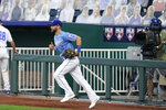 Kansas City Royals left fielder Alex Gordon takes the field for of a baseball game against the Detroit Tigers at Kauffman Stadium in Kansas City, Mo., Saturday, Sept. 26, 2020. (AP Photo/Orlin Wagner)