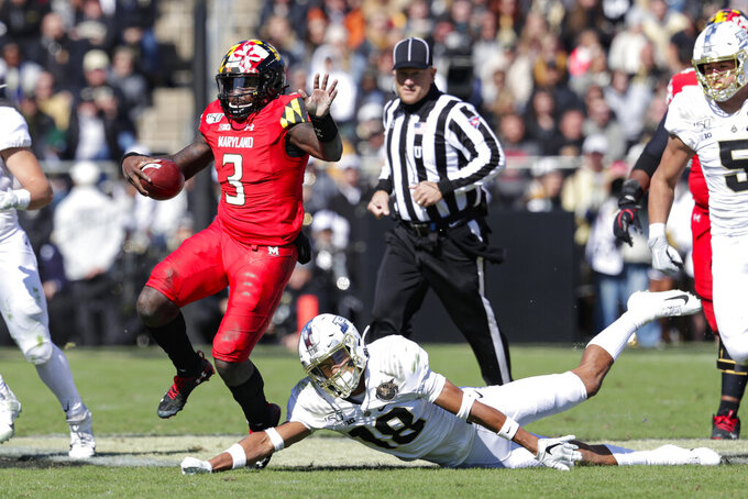 Maryland quarterback Tyrrell Pigrome (3) avoids the tackle of Purdue cornerback Cam Allen (18) during the second half of an NCAA college football game in West Lafayette, Ind., Saturday, Oct. 12, 2019. Purdue defeated Maryland 40-14. (AP Photo/Michael Conroy)