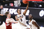 Oregon State's Gianni Hunt (0) makes it to the basket past Stanford's Noah Taitz (20) as teammate Dearon Tucker (35) looks on during the first half of an NCAA college basketball game in Corvallis, Ore., Monday, Jan. 4, 2021. (AP Photo/Amanda Loman)