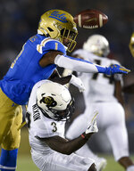 UCLA defensive back Darnay Holmes, left, breaks up a pass to Colorado wide receiver K.D. Nixon during the first half of an NCAA college football game in Los Angeles, Saturday, Nov. 2, 2019. (AP Photo/Kelvin Kuo)