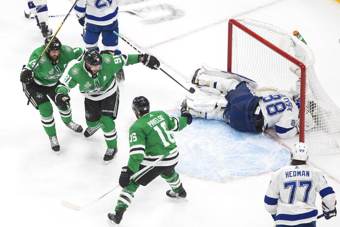 Dallas Stars center Joe Pavelski (16) celebrates his goal against Tampa Bay Lightning goaltender Andrei Vasilevskiy (88) with Tyler Seguin (91) and Jamie Benn (14) during the third period of Game 4 of the NHL hockey Stanley Cup Final, Friday, Sept. 25, 2020, in Edmonton, Alberta. (Jason Franson/The Canadian Press via AP)