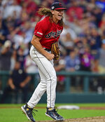 Cleveland Indians starting pitcher Mike Clevinger reacts after striking out Minnesota Twins' Max Kepler in the fifth inning of a baseball game, Friday, July 12, 2019, in Cleveland. (AP Photo/David Dermer)
