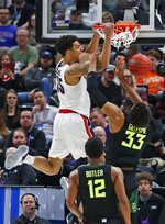 Gonzaga forward Brandon Clarke (15) dunks on Baylor's Freddie Gillespie (33) as Jared Butler (12) watches during the first half of a second-round game in the NCAA men's college basketball tournament Saturday, March 23, 2019, in Salt Lake City. (AP Photo/Rick Bowmer)