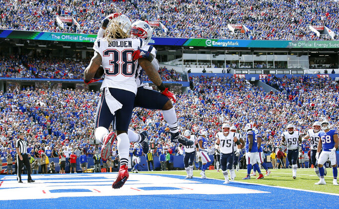 New England Patriots running back Brandon Bolden celebrates his touchdown run against the Buffalo Bills with James White, rear, in the first half of an NFL football game, Sunday, Sept. 29, 2019, in Orchard Park, N.Y. (AP Photo/Ron Schwane)