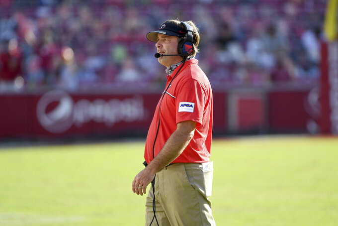 Georgia coach Kirby Smart talks to his team as they play against Arkansas during the first half of an NCAA college football game in Fayetteville, Ark., Saturday, Sept. 26, 2020. (AP Photo/Michael Woods)