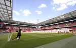 Aaron of FSV Mainz 05 takes a corner kick during the German Bundesliga soccer match between 1. FC Cologne and FSV Mainz 05 in Cologne, Germany, Sunday, May 17, 2020. The German Bundesliga is the world's first major soccer league to resume after a two-month suspension because of the coronavirus pandemic. (AP Photo/Lars Baron, Pool)
