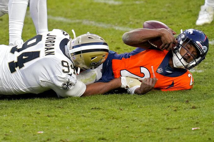 New Orleans Saints defensive end Cameron Jordan (94) sacks Denver Broncos quarterback Kendall Hinton (2) during the second half of an NFL football game, Sunday, Nov. 29, 2020, in Denver. (AP Photo/David Zalubowski)