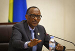 Rwanda's President Paul Kagame answers questions from the media at a press conference at a convention center in the capital Kigali, Rwanda Monday, April 8, 2019. Rwanda on Sunday commemorated the 25th anniversary of when the country descended into an orgy of violence in which some 800,000 Tutsis and moderate Hutus were massacred by the majority Hutu population over a 100-day period in what was the worst genocide in recent history. (AP Photo/Ben Curtis)