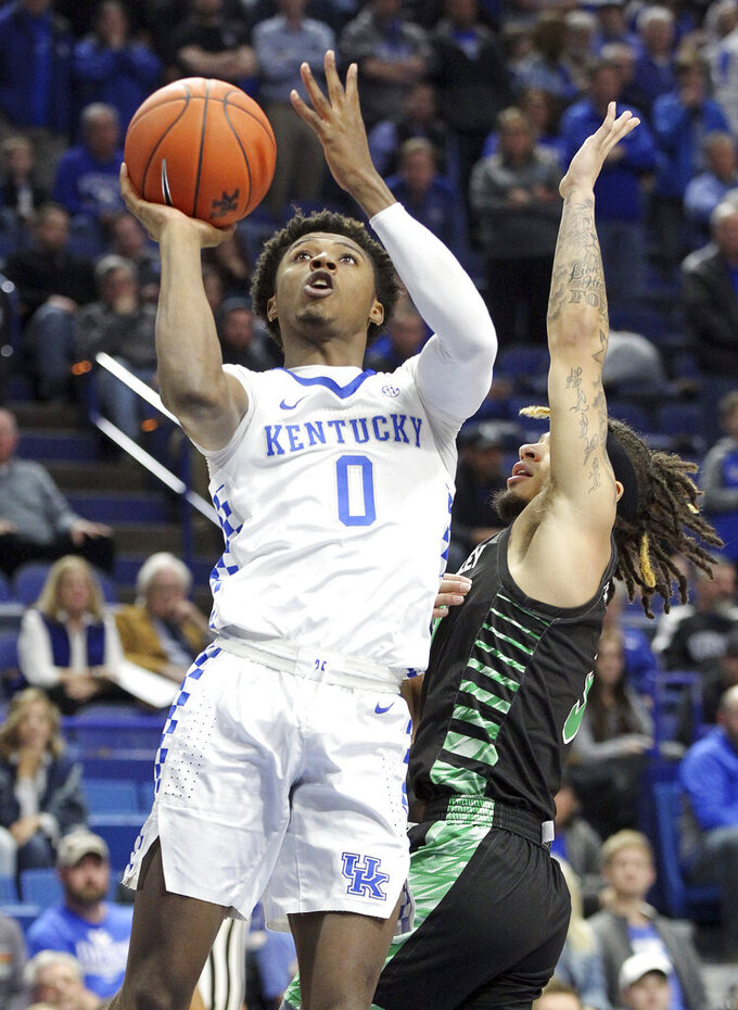 Kentucky's Ashton Hagans (0) shoots while defended by Utah Valley's TJ Washington during the first half of an NCAA college basketball game in Lexington, Ky., Monday, Nov. 18, 2019. (AP Photo/James Crisp)