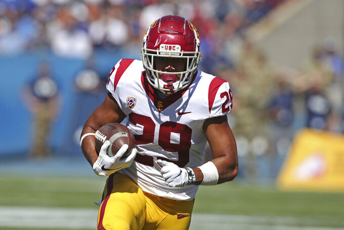 Southern California running back Vavae Malepeai (29) runs the ball in the first half against BYU during an NCAA college football game, Saturday, Sept. 14, 2019, in Provo, Utah. (AP Photo/George Frey)