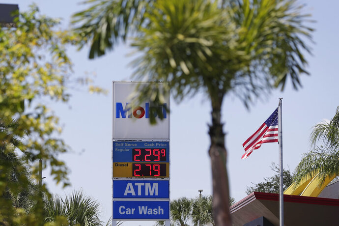 FILE - In this Sept. 17, 2019, file  photo, a sign outside a gas station displays current prices for fuel in Orlando, Fla. The Labor Department said Tuesday, Jan. 14, 2020, that its consumer price index rose 0.2% last month, lifted by a 2.8% increase in gasoline prices. (AP Photo/John Raoux, File)