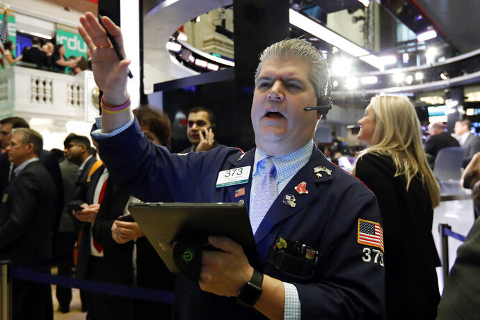 FILE - In this April 11, 2019, file photo trader John Panin works on the floor of the New York Stock Exchange. The U.S. stock market opens at 9:30 a.m. EDT on Tuesday, May 7. (AP Photo/Richard Drew, File)