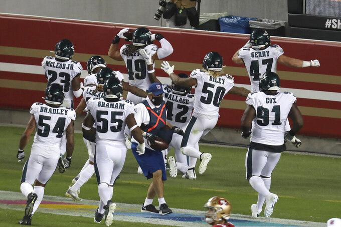 Philadelphia Eagles linebacker Alex Singleton (49) celebrates with teammates after returning an interception for a touchdown during the second half of an NFL football game against the San Francisco 49ers in Santa Clara, Calif., Sunday, Oct. 4, 2020. (AP Photo/Jed Jacobsohn)