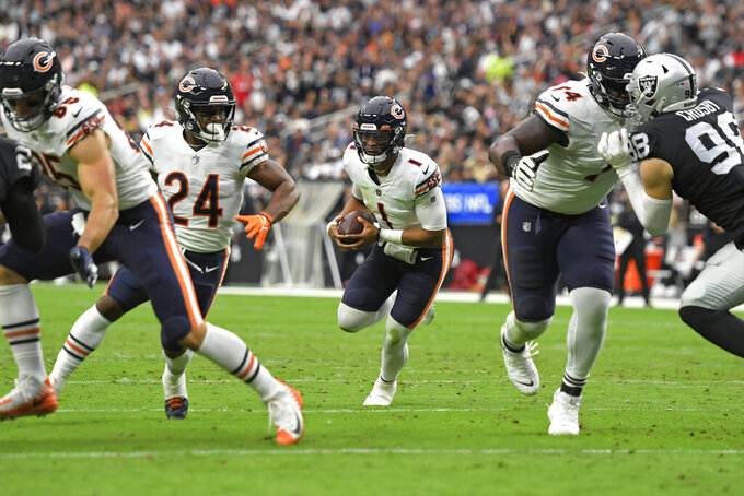 Chicago Bears quarterback Justin Fields (1) runs against the Las Vegas Raiders during the first half of an NFL football game, Sunday, Oct. 10, 2021, in Las Vegas. (AP Photo/David Becker)