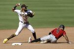 FILE - In this July 27, 2020, file photo, San Diego Padres shortstop Fernando Tatis Jr., left, throws to first after forcing out Arizona Diamondbacks' Ketel Marte at second during the seventh inning of a baseball game in San Diego. Tatis continues to shine as one of the baseball's bright young stars, building on his electrifying first season when he finished third in the NL Rookie of the Year voting despite playing in only 84 games due to injuries. (AP Photo/Gregory Bull, File)