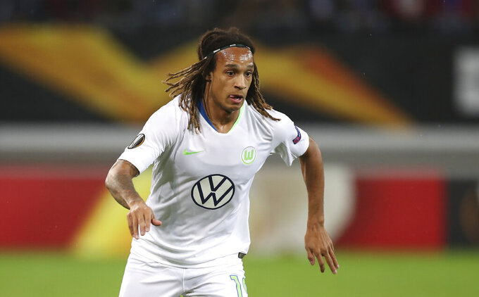 FILE - In this file photo dated Thursday, Oct. 24, 2019, Wolfsburg's Kevin Mbabu during the Europa League group I soccer match against Gent at KAA Gent Stadium in Ghent, Belgium. Wolfsburg defender Kevin Mbabu will miss his team's Europa League last-16 game against Shakhtar Donetsk after he tested positive for the coronavirus last month, the club said in a statement Monday Aug. 3, 2020.(AP Photo/Francisco Seco, FILE)