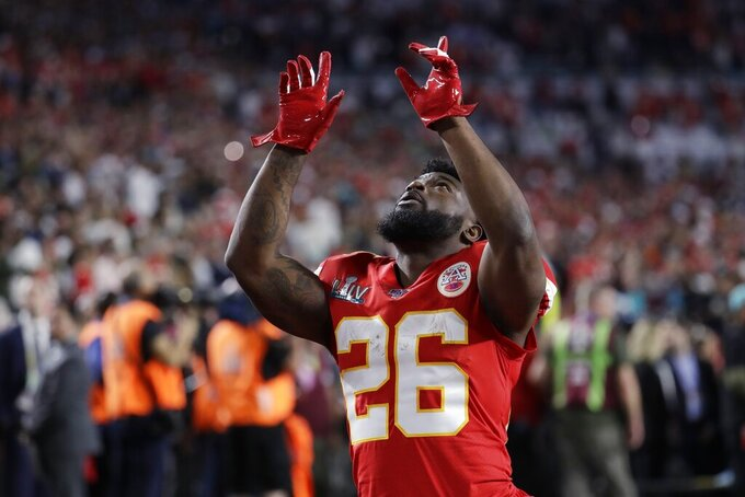 Kansas City Chiefs' Damien Williams points up before the NFL Super Bowl 54 football game between the San Francisco 49ers and Kansas City Chiefs Sunday, Feb. 2, 2020, in Miami Gardens, Fla. (AP Photo/Lynne Sladky)