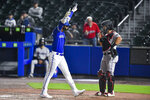 Toronto Blue Jays' Lourdes Gurriel Jr., left, celebrates in front of Miami Marlins catcher Jorge Alfaro, right, after hitting a solo home run during the eighth inning of a baseball game in Buffalo, N.Y., Tuesday, June 1, 2021. (AP Photo/Adrian Kraus)