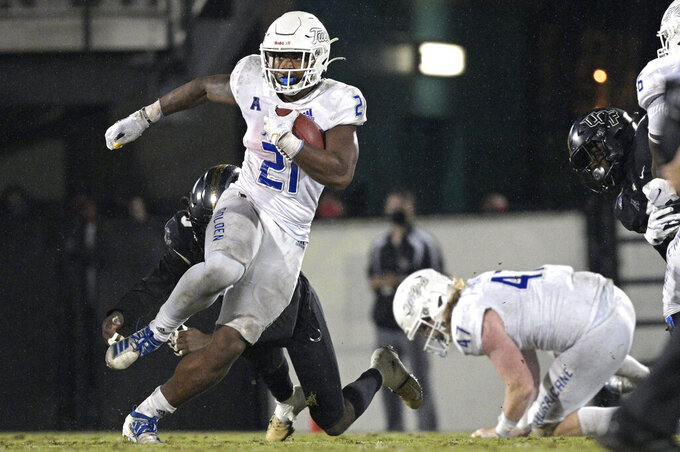 Tulsa running back T.K. Wilkerson (21) rushes past Central Florida defensive back Antwan Collier (3) during the second half of an NCAA college football game Saturday, Oct. 3, 2020, in Orlando, Fla. (AP Photo/Phelan M. Ebenhack)