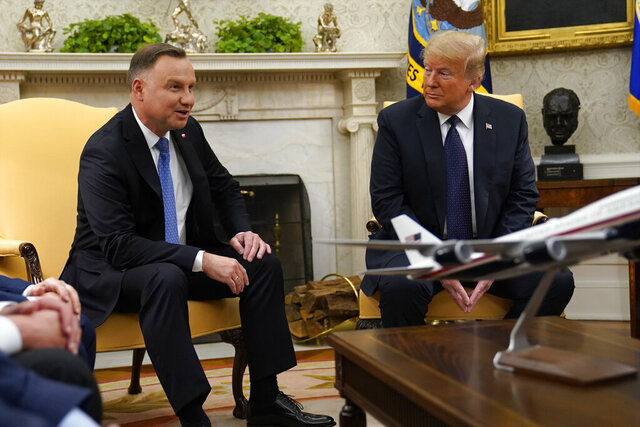 President Donald Trump meets with Polish President Andrzej Duda in the Oval Office of the White House, Wednesday, June 24, 2020, in Washington. (AP Photo/Evan Vucci)