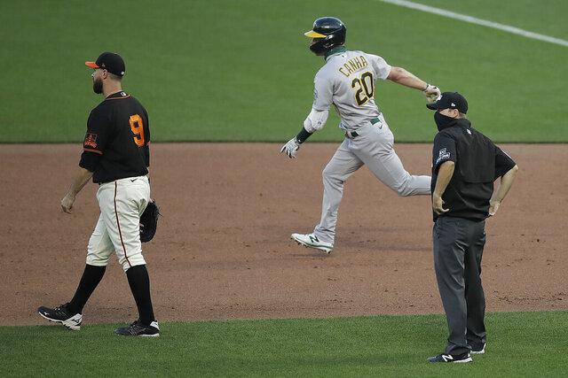 Oakland Athletics' Mark Canha (20) runs the bases after hitting a three run homerun off San Francisco Giants' Trevor Gott in the ninth inning of a baseball game Saturday, Aug. 15, 2020, in San Francisco. (AP Photo/Ben Margot)