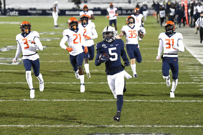FILE - In this Dec. 19, 2020, file photo, Penn State wide receiver Jahan Dotson (5) scores a touchdown on a 75-yard pass in the first quarter of an NCAA college football game against Illinois in State College, Pa. Dotson opted to return for his final season for a number of reasons. He wanted to get bigger, faster and stronger. He also wanted to help the program re-establish itself as an offensive powerhouse after a disappointing 2020 (AP Photo/Barry Reeger, File)