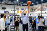 California Gov. Gavin Newsom shoots hoop with Golden State Warriors guard Damion Lee, left, during a visit to the team's training facility, which is serving as a polling location, on Tuesday, Nov. 3, 2020, in Oakland, Calif. (AP Photo/Noah Berger)