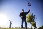 Lynn Blaser, of Adel, pickets outside of John Deere Des Moines Works on Thursday, Oct. 14, 2021, in Ankeny, Iowa. The Deere workers' strike began at midnight. (Kelsey Kremer /The Des Moines Register via AP)