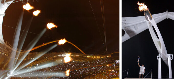 The Olympic cauldron rises in this multiple exposure photo, left, after Nikolas Kaklamanakis, right, lit it during the Opening Ceremony of the 2004 Olympic Games in Athens, Friday, Aug. 13, 2004. The photo at left is a single frame time exposure interrupted at six intervals while the Olympic cauldron rises after being lit. (AP Photos)
