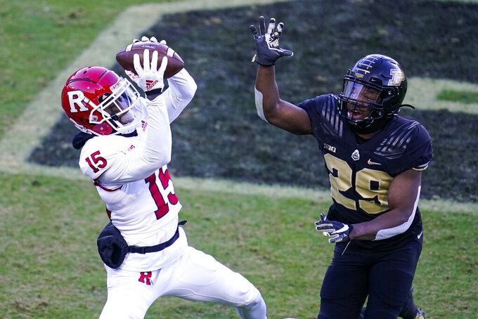 Rutgers wide receiver Shameen Jones (15) makes a catch in front of Purdue cornerback Simeon Smiley (29) for a touchdown during the first quarter of an NCAA college football game in West Lafayette, Ind., Saturday, Nov. 28, 2020. (AP Photo/Michael Conroy)
