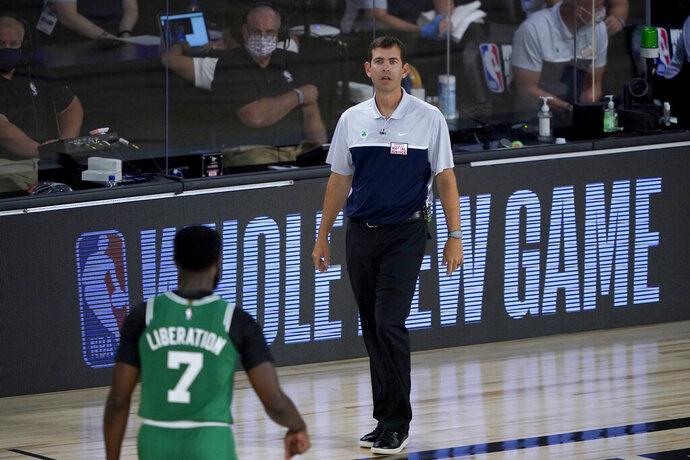 iBoston Celtics head coach Brad Stevens looks toward Jaylen Brown (7) during the first half of an NBA basketball game against the Milwaukee Bucks Friday, July 31, 2020, in Lake Buena Vista, Fla. (AP Photo/Ashley Landis, Pool)