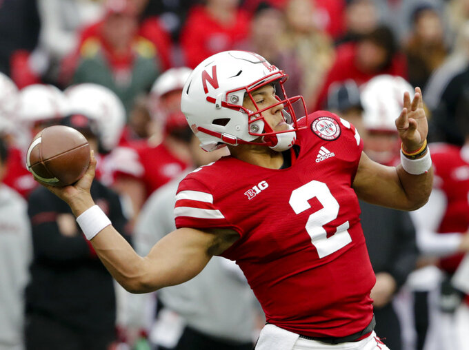 FILE - In this Saturday, Sept. 29, 2018, file photo, Nebraska quarterback Adrian Martinez (2) throws a pass during the first half of an NCAA college football game against Purdue in Lincoln, Neb. Four starts into his career, Martinez already is showing signs of blossoming into the next standout quarterback coached by Scott Frost. (AP Photo/Nati Harnik, File)