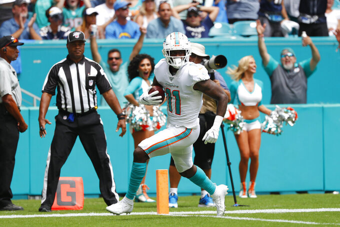Miami Dolphins wide receiver DeVante Parker (11) runs for a touchdown, during the first half at an NFL football game against the Los Angeles Chargers, Sunday, Sept. 29, 2019, in Miami Gardens, Fla. AP Photo/Wilfredo Lee)