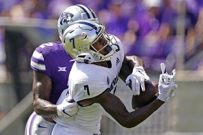 Nevada wide receiver Romeo Doubs (7) catches a pass under pressure from Kansas State defensive back Russ Yeast (2) during the first half of an NCAA college football game Saturday, Sept. 18, 2021, in Manhattan, Kan. (AP Photo/Charlie Riedel)