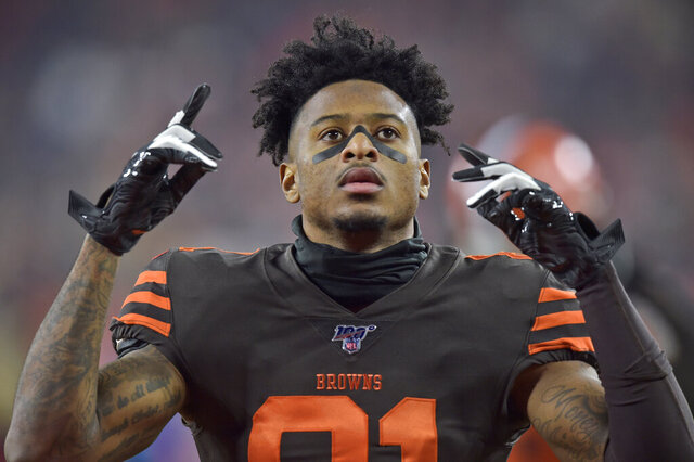 FILE - In this Nov. 14, 2019, file photo, Cleveland Browns wide receiver Rashard Higgins gestures before an NFL football game against the Pittsburgh Steelers in Cleveland. Higgins has agreed to a one-year contract to stay with the Cleveland Browns, a person familiar with the agreement told The Associated Press on Tuesday, April 28, 2020. (AP Photo/David Richard, File)