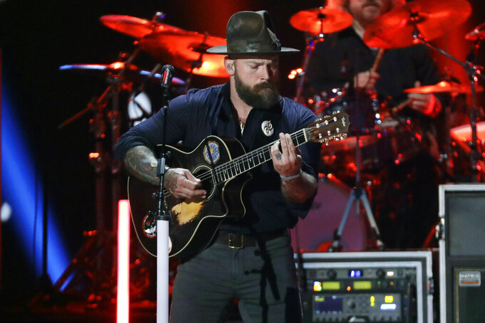"FILE - In this June 5, 2019, file photo, Zac Brown performs at the CMT Music Awards in Nashville, Tenn. The Zac Brown Band is going to lend its sound to the NFL. The Atlanta-based group will give its 2008 hit ""Chicken Fried"" a holiday twist for the Thanksgiving night matchup between the hometown Falcons and rival New Orleans Saints. (AP Photo/Mark Humphrey, File)"