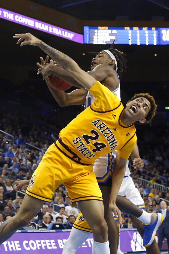 UCLA forward Jalen Hill, back, is fouled by Arizona State forward Jalen Graham (24) during the first half of an NCAA college basketball game Thursday, Feb. 27, 2020, in Los Angeles. (AP Photo/Ringo H.W. Chiu)