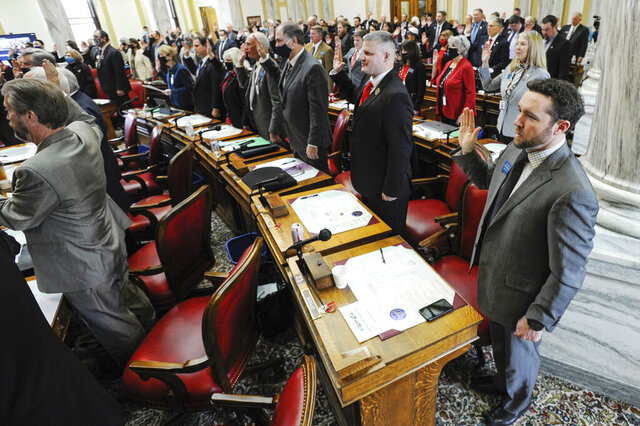 Legislators from the House of Representatives are sworn in to office at the State Capitol on Monday, Jan. 4, 2021, in Helena, Mont. (Thom Bridge/Independent Record via AP)